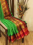 Semi silk saree green and maroon with self emboss and zari border