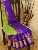Kuppadam silk cotton saree green and violet with zari woven buttas and ikat border