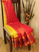 Kuppadam silk cotton saree lime green and red with zari woven buttas and ikat border