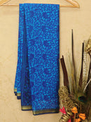 Semi crepe saree blue with all over prints and zari border