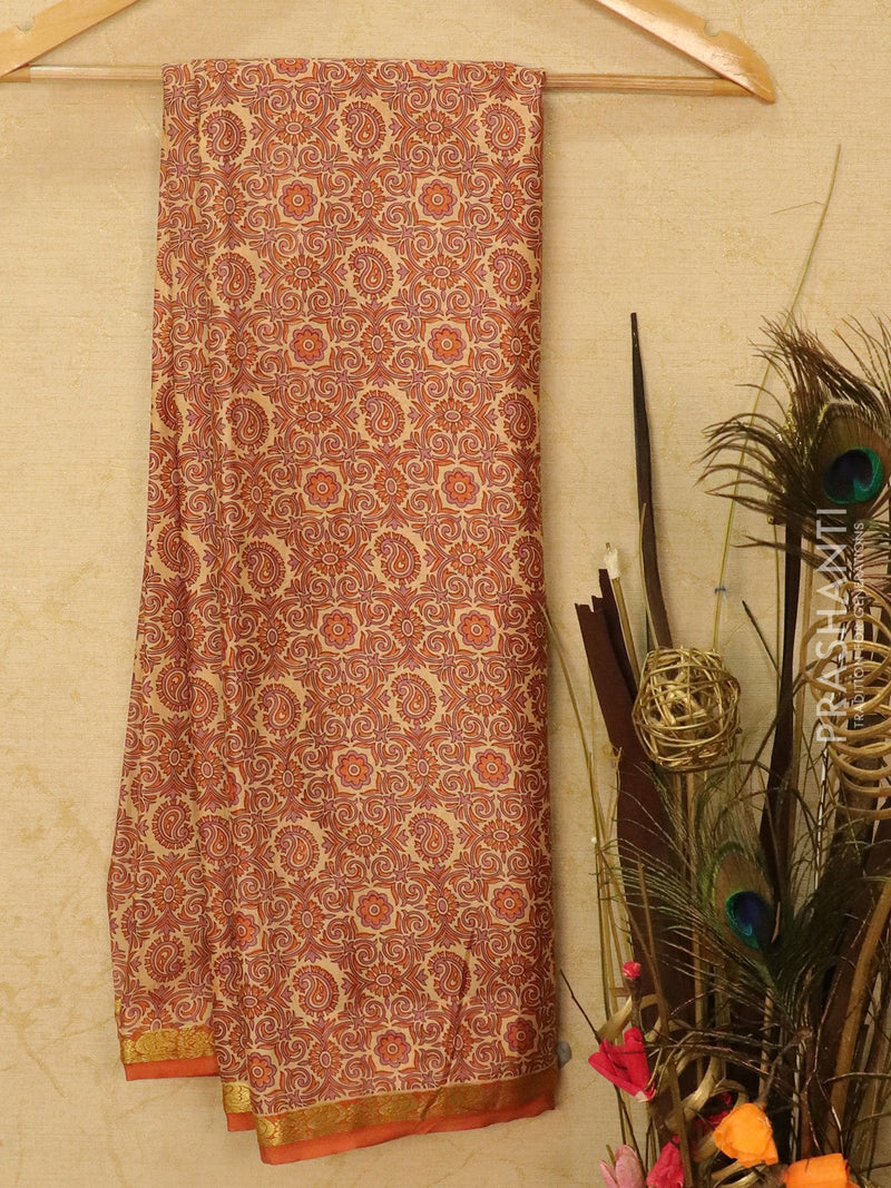 Semi crepe saree beige and rust with all over prints and zari border