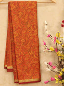 Semi crepe saree mustard orange with all over prints and zari border