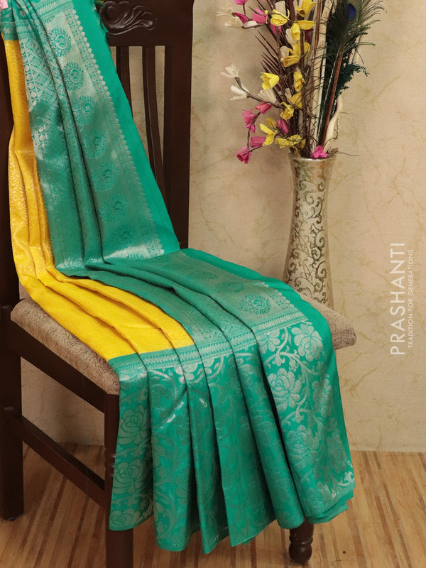Pure Kanjivaram silk saree yellow and teal green with allover floral zari weaves and rich woven silver zari border