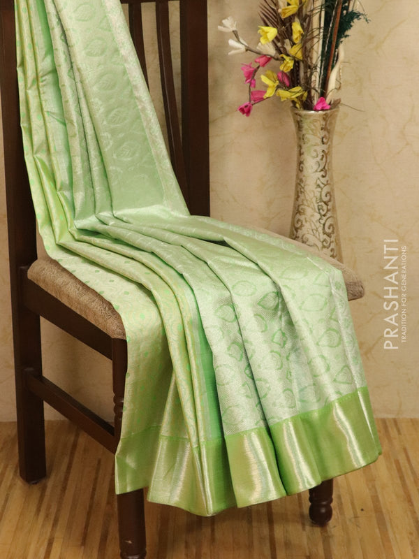Pure Kanjivaram silk saree pastal green tissue with allover zari weaves and rich zari border for Rs.Rs. 20800.00 | by Prashanti Sarees