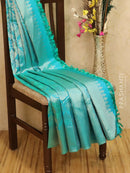 Pure Kanjivaram silk saree blue tissue with allover thread and zari weaves with buttas plain border