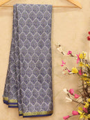 Semi crepe saree grey and blue with all over prints and zari border