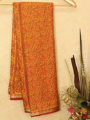 Semi crepe saree yellow and maroon with all over prints and zari border
