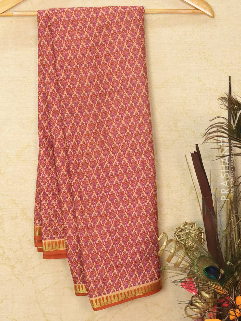 Semi crepe saree peach shade and rust with all over prints and zari border