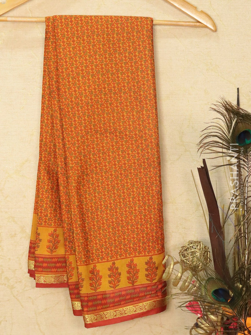 Semi crepe saree mustard and rustic brown with all over prints and zari border