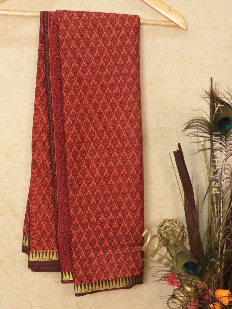 Semi crepe saree rust shade and brown with all over prints and zari border