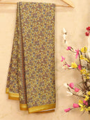 Semi crepe saree pastal green and mustard with all over prints and zari border