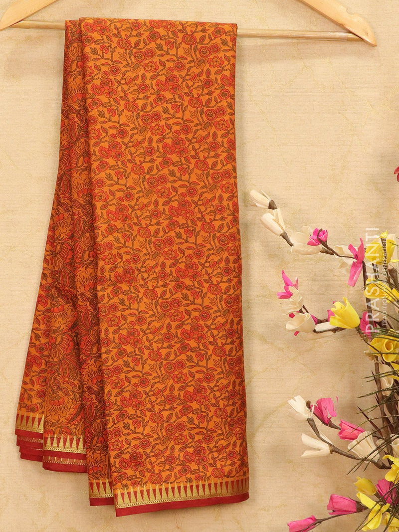 Semi crepe saree rust and maroon with all over prints and zari border