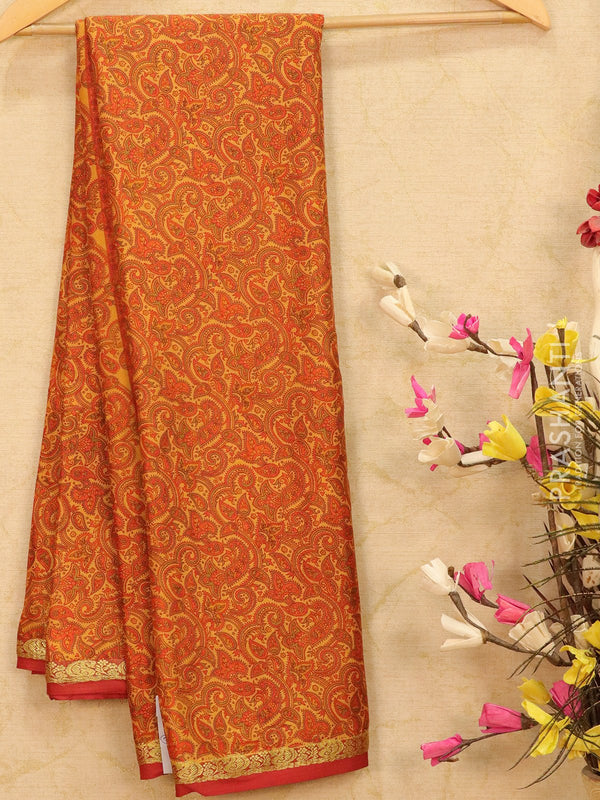 Semi crepe saree mustard and maroon with all over prints and zari border