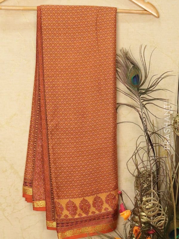 Semi crepe saree peach and rust with all over prints and zari border