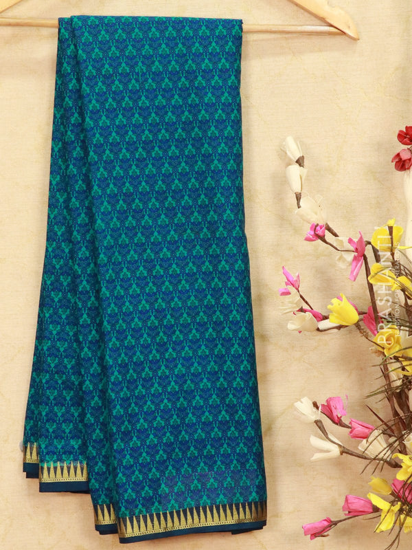 Semi crepe saree green and blue with all over prints and zari border