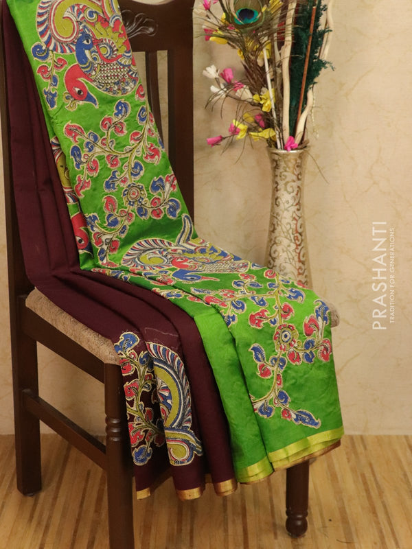 Silk cotton saree coffee brown and green with kalamkari applique work and golden zari piping border