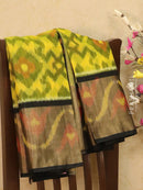 Ikat silk cotton saree yellow and black with all over ikat weaves and long zari woven border