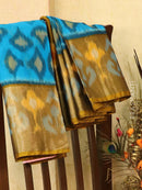 Ikat silk cotton saree cs blue and honey with all over ikat weaves and long zari woven border