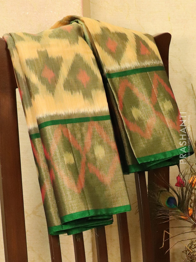 Ikat silk cotton saree beige and green with all over ikat weaves and long zari woven border