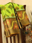 Ikat silk cotton saree light green and honey with all over ikat weaves and long zari woven border