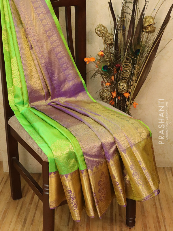 Pure kanjivaram silk saree green and violet with allover self emboss and buttas with rich zari border
