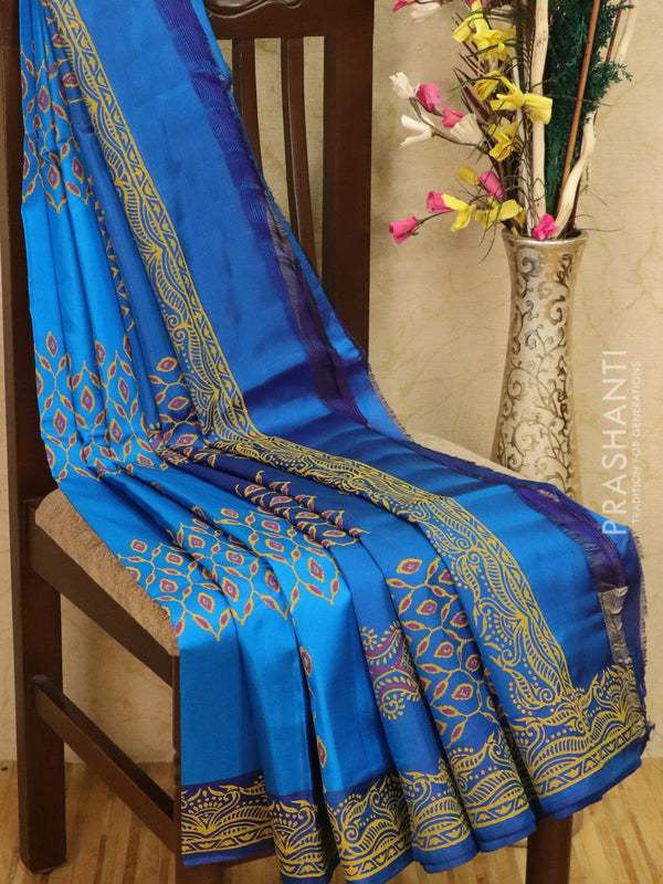 Pure Uppada silk saree cs blue and blue with allover prints in zariless style