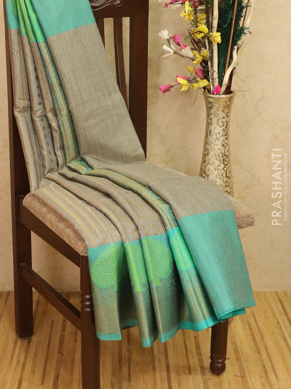 Manipuri tissue kota saree dark grey and teal with allover weaves and zari border