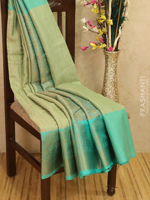 Manipuri tissue kota saree pastal green and teal with allover weaves and zari border