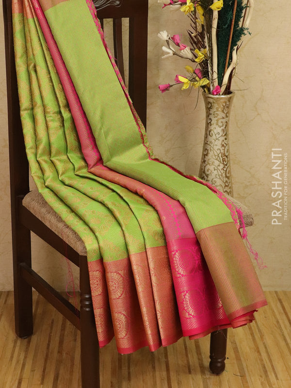 Tissue saree green and pink with allover weaves and buttas with zari border