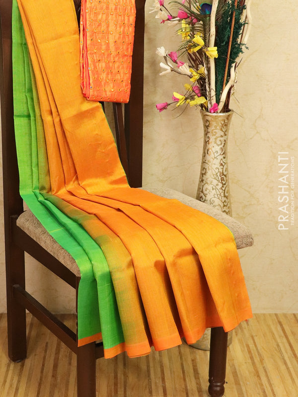 Silk cotton saree green and orange with pipping border and mirror work blouse