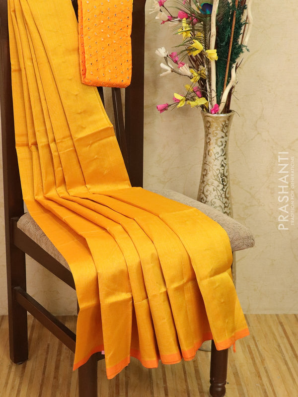 Silk cotton saree mango yellow with pipping border and mirror work blouse
