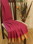 Kanchi cotton sarees magenta pink with allover checked and small buttas in simple woven border