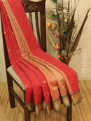 Kanchi cotton sarees red with allover checked and small buttas in simple woven border