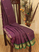 Kanchi cotton sarees deep purple and green with allover checked pattern and small buttas in thread woven border