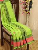 Kanchi cotton sarees light green with checked pattern and alternate buttas in simple border