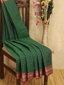 Kanchi cotton sarees green with allover checked pattern and thread woven border
