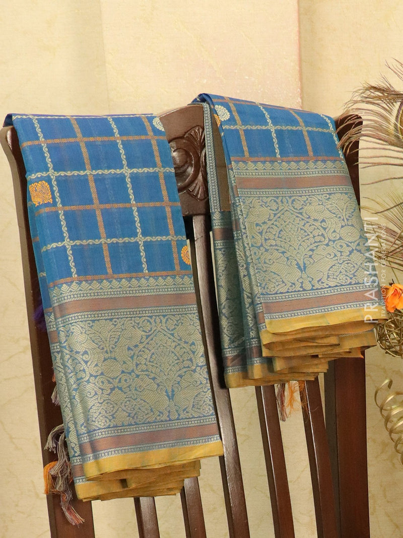 Kanchi cotton sarees blue with allover checked pattern and thread woven border
