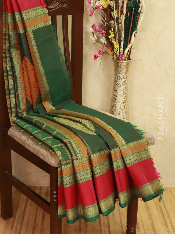 Kanchi cotton sarees green and pink with all over checks and buttas in thread woven border