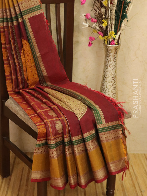 Kanchi cotton sarees maroon and mustard with all over checks and buttas in thread woven border