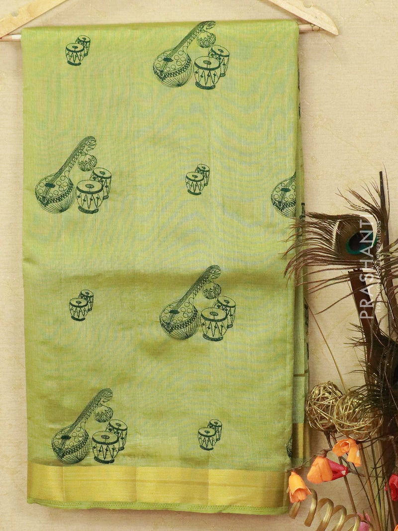 Semi tussar saree pista green with embroided pattern