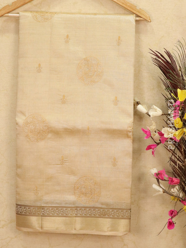 Semi tussar saree cream with embroided pattern