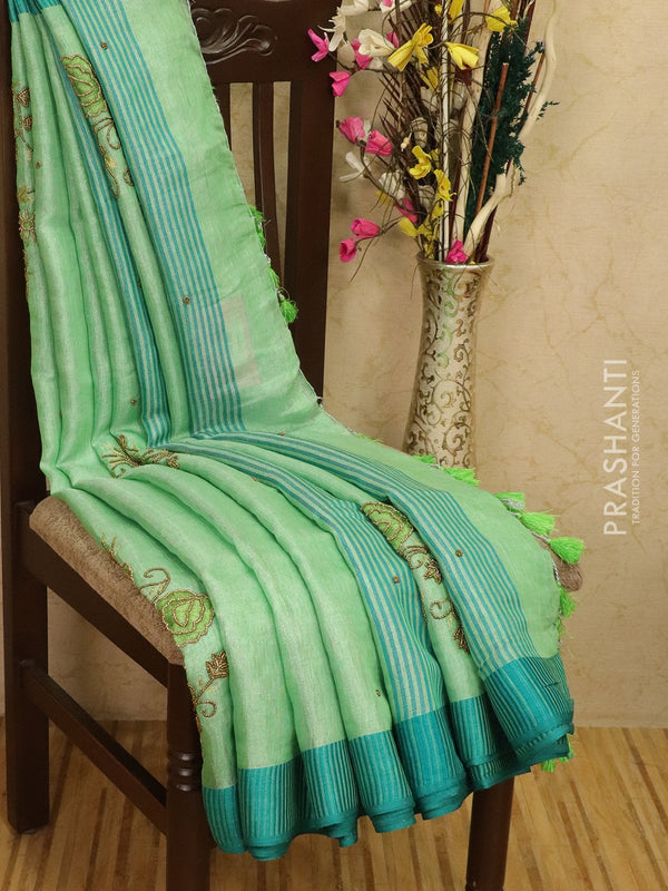Pure linen tissue saree green with embroided work