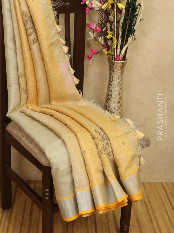 Pure linen tissue saree mild yellow with embroided work