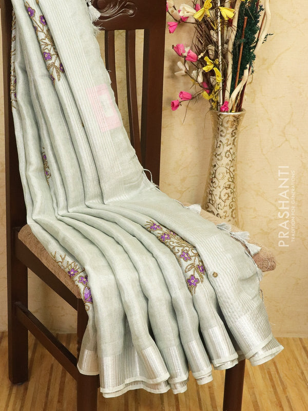 Pure linen tissue saree greyish silver with embroided work
