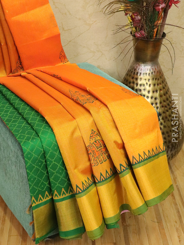 Block printed silk cotton partly saree orange and green with butta prints and zari border