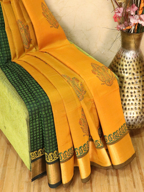Block printed silk cotton partly saree mustard and green with butta prints and zari border