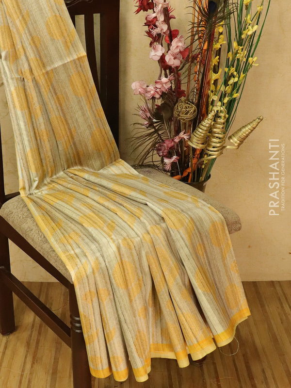Semi jute silk saree beige and yellow with thread woven butttas and piping border