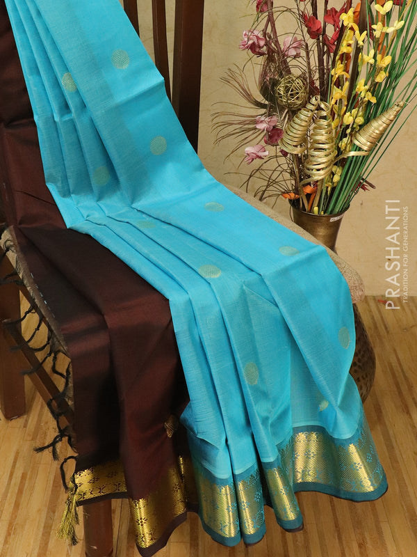 Silk cotton partly saree blue and coffee brown with coin buttas and woven zari border