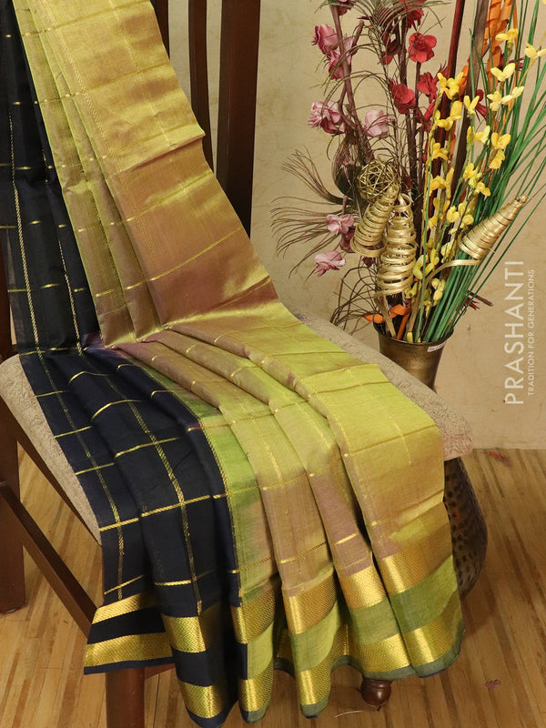 Silk cotton partly saree dual shade of green purple and navy blue with zari checks and rettapet border