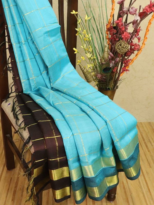 Silk cotton partly saree blue and coffee brown with zari checks and rettapet border